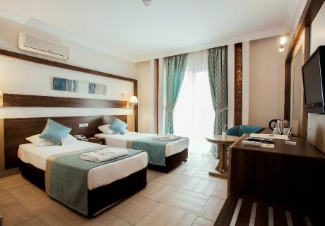 Located in flora garden area of the hotel. Room with twin beds or twin beds plus a bunk bed offers balcony with view to Flora garden.<br><br>